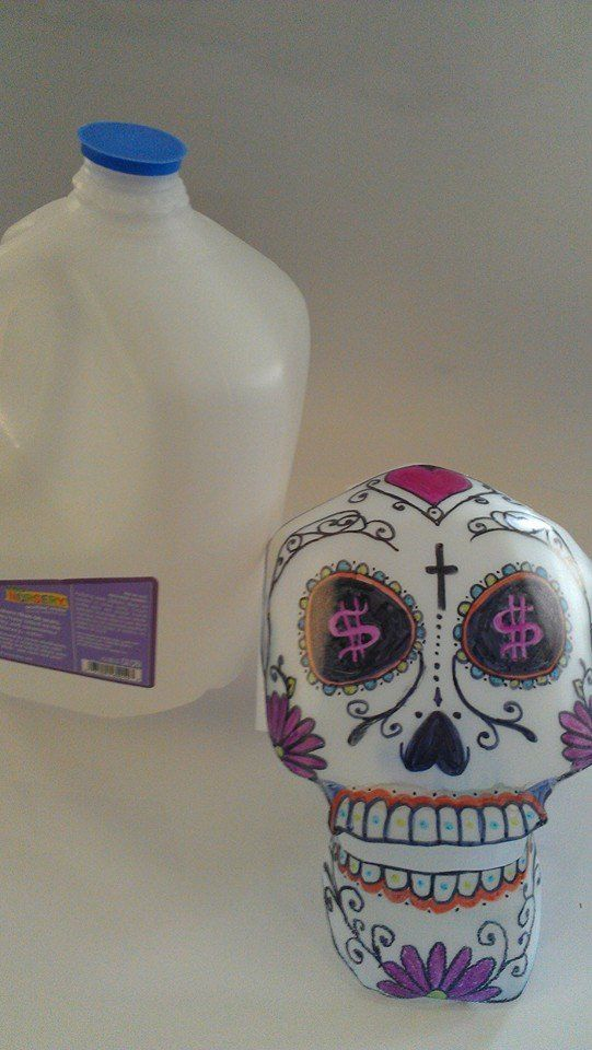 Gallon Jug Sugar Skull Craft. Dia de los Muertos. We used sharpies for the decoration. There is a tutorial for the skull on YouTube - (Upcycled, DIY, Homemade, Reused, Recycled, Plastic, Milk Jug, Water Jug):