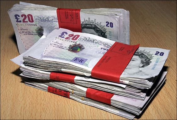 British sterling pounds. Lots of money, lovely big wads.