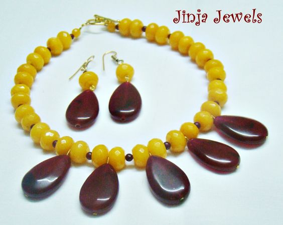 One of Jinja Jewels' creations, yellow jades and maroon agates. In love with it! Would go well with a western dress!! :)