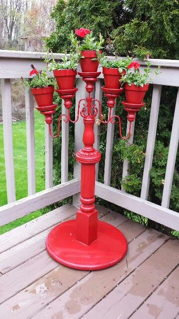 Flower stand made from a candleabra, terra cotta pots, a baluster, wood table top, some glue and paint.: