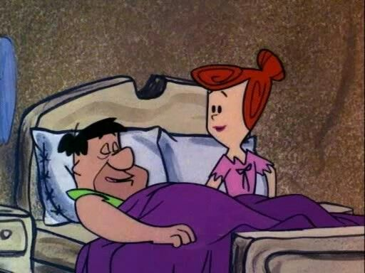 The first couple to be shown in bed together on prime time TV were Fred and Wilma  Flintstone.   Flintstones, Cartoon, Fred and wilma flintstone