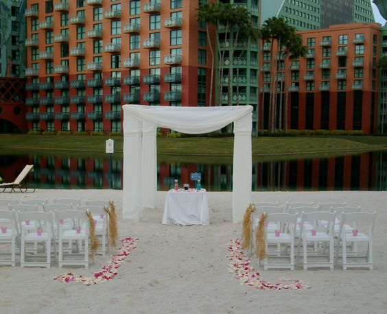 Beach wedding location at the Disney Swan and Dolphin Hotel by Just Marry. This venue is great for destination wedding ceremonies. #harpist #Orlando #music #musician #ceremony