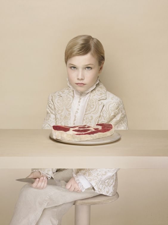 """"""" artnet: L'Enfant Terrible. Contrasting the sophisticated young boy with the raw meat in front of him, Laetitia Soulier explores what gets repressed in the process of civilization, a concept..."""