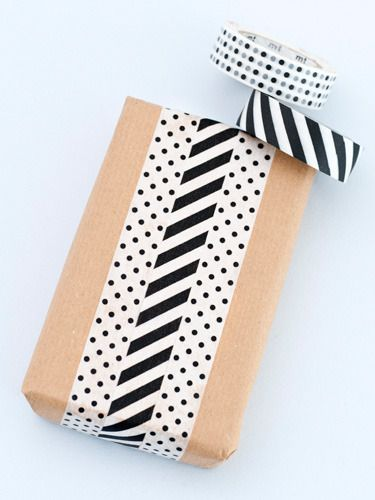 Gift wrapping for mailing packages. Use colorful tape to create the idea of ribbon on the brown paper package. Then put on the address labels.