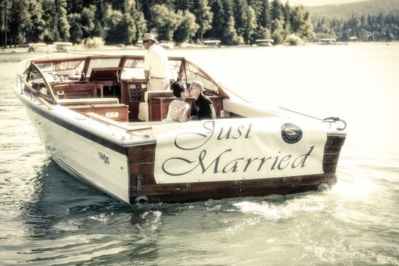 Just Married Boat on Whitefish Lake after the ceremony at The Lodge at Whitefish - Photo by www.nateschmidtphotography.com/  edited by www.celebratingbliss.com/