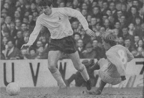 21st March 1970. Tottenham midfield star Martin Peters tackled by Coventry…