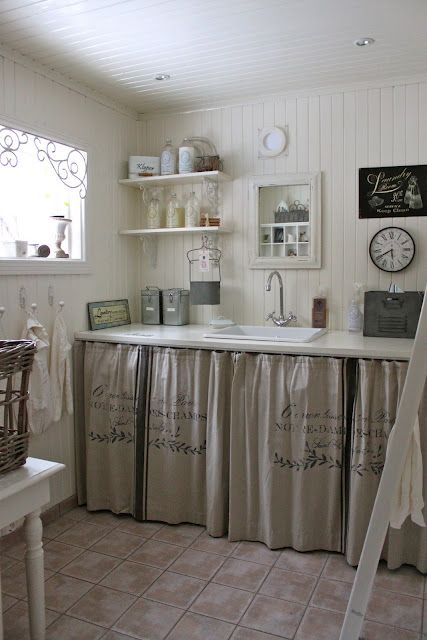 grain sack curtains under laundry counter-- could be cute made into cafe curtains for the kitchen: