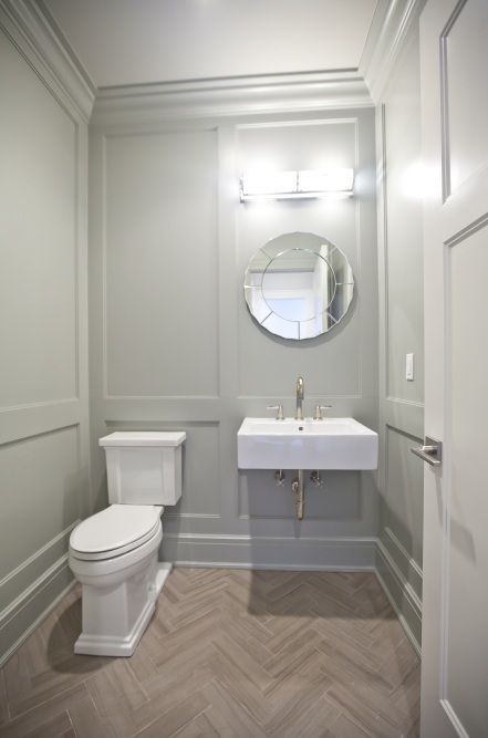Gray Paneled Powder Room Walls Floating Sink