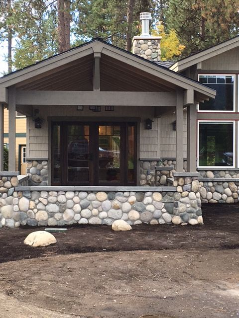 Wonderful Remodel Gives A Great Update With Classic Natural Stone Thin Veneer River Rock And Bluestone D Stone Exterior Houses Stone Front House Exterior Stone
