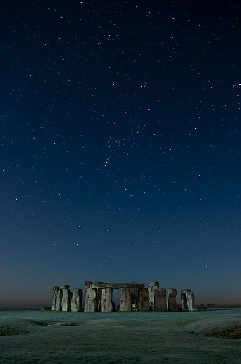 Stonehenge, prehistoric monument located in Wiltshire, England, UK - under starry night