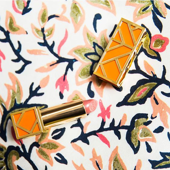 Lip service… encased in chic gold and orange fretwork