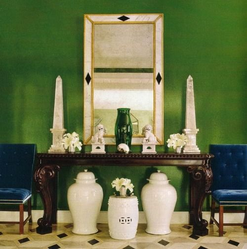 emerald green foyer with pretty white pottery