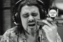 """Robert Weston Smith was an ordained minister (Reverend Jack) who went on to become pioneer disc jockey """"Wolfman Jack"""" on XERF AM radio (1570) from 1958-1966 and into syndication later in his career."""