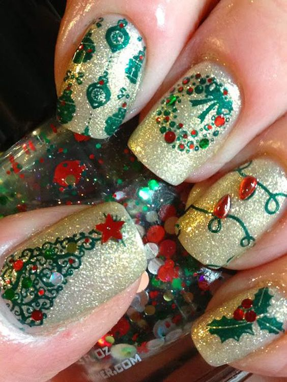 Glittery and gorgeous looking Christmas inspired nail art. Fill up your nails in wonderful glitters of all colors and add embellishments such as beads on top as accent to the designs.