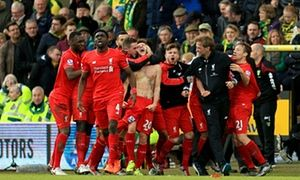 Adam Lallana and Jürgen Klopp lead wild celebrations after Lallana's last-gasp winner.