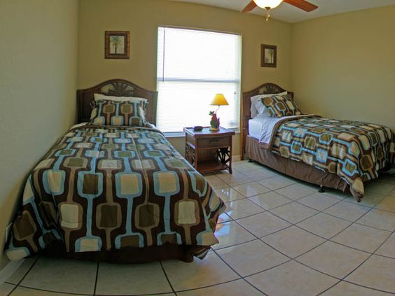 "Fourth bedroom features 2 twin beds and 26"" tv."