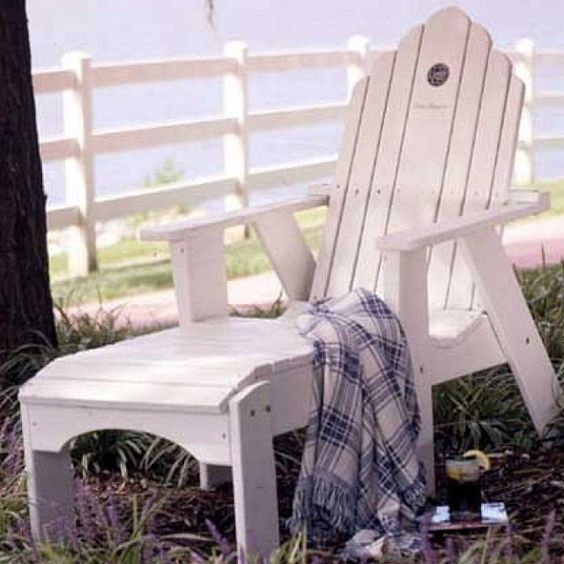 We love Adirondack chairs and think every well-dressed back yard needs at least two!  We especially love them by Uwharrie Chair Company.  They're hand-crafted, heavy and built to last a lifetime and also come in bright colors. #mainandgray #mainandgrayhome #interiordesign #fortmill #charlotte #uwharriechair