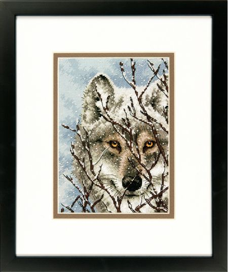 Dimensions Wolf - Cross Stitch Kit. A magnificent wolf keeps a watchful eye over his surroundings in this wintry counted cross stitch scene by Dimensions. Part