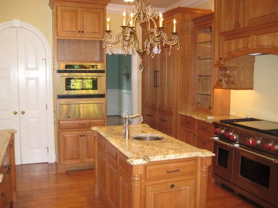 Custom Light Stained Kitchen Cabinetry And Island With Wall Oven