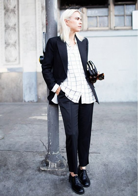 Loving Always Judging blogger in a simple black suit worn with a windowpane blouse and brogues. Perfect office look.
