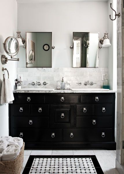 bathroom with black vanity pale grey walls and marble tile counter kansas