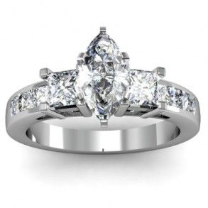 Marquise & Princess Cut 3 Stone Diamond Engagement Ring - Beautiful stones are the highlight of this Marquise & Princess Cut 3 Stone Diamond Engagement Ring set in 14k White Gold placed in a Channel setting featuring a White Marquise cut center stone with 2 White Princess cut accent stones on each side & shank. The Marquise & Princess Cut engagement ring comes with an SI2 in clarity with a G in color & the gem weight is equal to 2.0 carats. The diamonds are 100% natural…