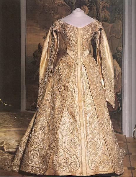 Cloth of gold coronation gown worn by Alexandra Feodorovna of Russia (6th June 1872 – 17th July 1918) for her coronation 1894. Dresses ordered for the imperial family were embroidered at the Novotikhvinsky Convent workshop that specialized in gold threadwork.
