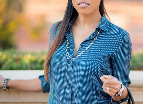 Blue polka dot blouse and black slacks