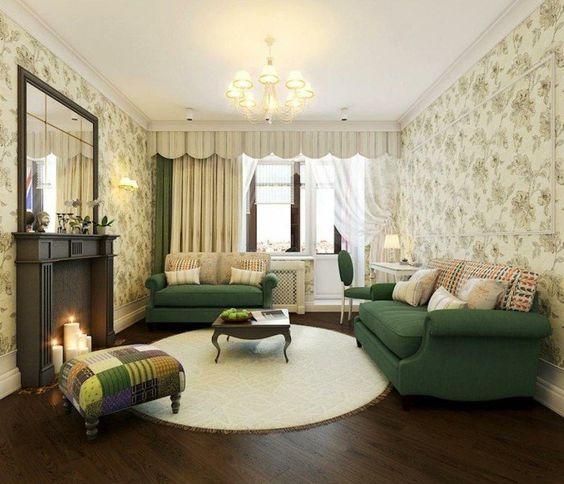 runde teppiche wohnzimmer einrichten grüne sofas kerzen schöne wandtapete