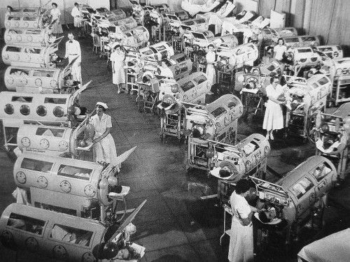 Polio patients in iron lungs in 1952.