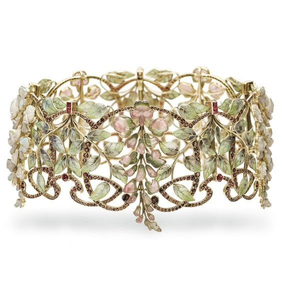 AN ART NOUVEAU MULTI-GEM AND ENAMEL 'GLYCINES' TOUR-DE-COU, BY PHILIPPE WOLFERS, CIRCA 1900. Designed as five alternating carved watermelon tourmaline and opal wisterias, between purple and green plique-à-jour enamel scrolling leaf clusters, enhanced by scrolling garnet-set accents and ruby details, mounted in gold. With maker's mark for Philippe Wolfers, signed Ex-Unique for 'Exemplaire unique' #Wolfers #ArtNouveau #chocker #collar: