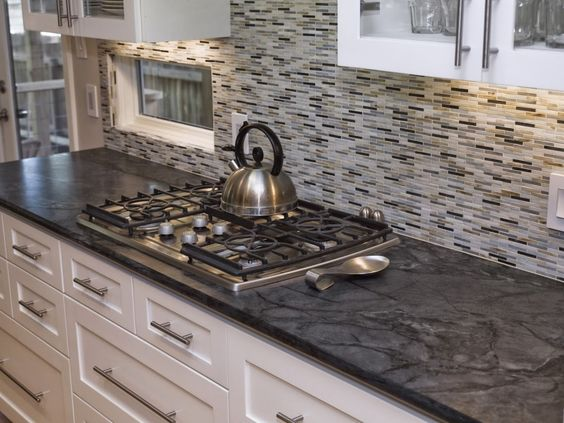 Kitchen Kitchen Furniture Interesting Grey Mosaic Tile Backsplash And Dark Motives Soapstone Countertops And Top Stove Over White Cabinets In Modern Kitchen Designs Enchanting Soapstone Countertops For Kitch Kitchen Backsplash White Cabinets Black Countertop