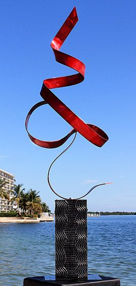 Red Perfect Moment by Jon Allen | This contemporary metal art piece is a graceful defiance of gravity, a weightless element that rests lightly on a curved foot and flies heavenward. #Metal #Sculpture #Art #InteriorDesign #HomeDecor #InteriorDesignIdeas See More: http://www.statements2000.com/sculptures/red_perfect_moment_contemporary_metal_sculpture_by_artist_jon_allen/