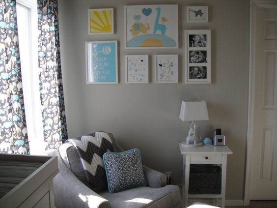 Adorable gallery wall art in this modern gray nursery