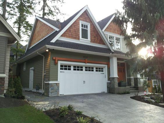 I like the cedar shakes green siding white windows same for Shakes on house