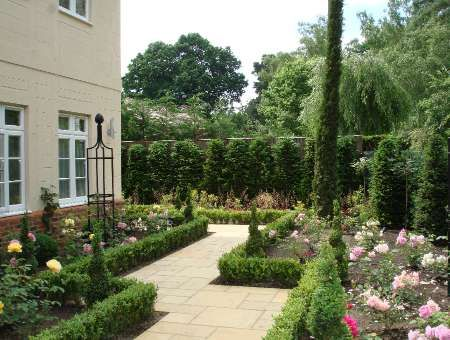 Formal gardens front gardens and surrey on pinterest for Formal front garden ideas