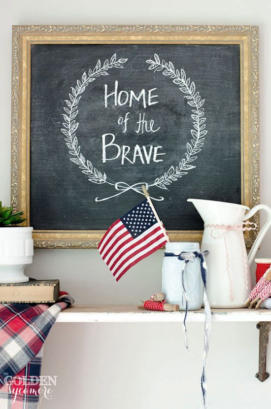 Spruce up an indoor event with a patriotic-themed mantelpiece. Decorate a chalkboard and surround it with small hints of red, white, and blue.