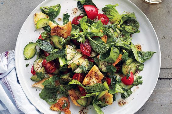 Middle Eastern Fattoush - Our favorite tip for fattoush: coat the toasted pita in olive oil before tossing it in with the other vegetables and dressing. #salad