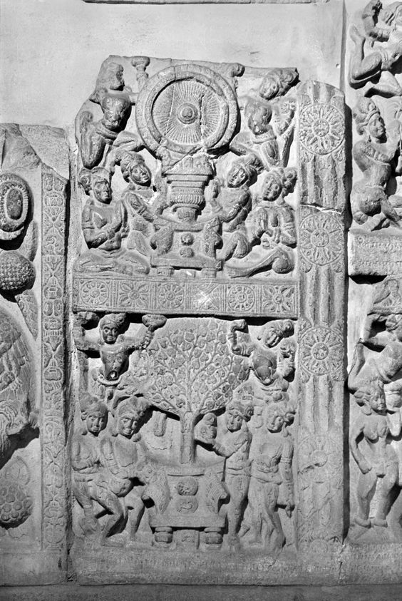Devotion to seat and dharmacakra-pillar (above), and devotion to seat and bodhi tree (below).  Casing slab fragment, relief sculpture, White marble,  Satavahana, India, Amaravati, Guntur Dt., Andhra Pradesh, ca. 2nd century CE, Madras Government Museum, Madras, Tamil Nadu