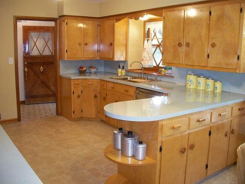 This family took a dilapidated midcentury kitchen and restored the water damaged cabinets to look like this.  They did have to rebuild a few of the cabinets, but they were able to save some, too.  Rather than rip out our cabinets and replace with new (something we really can't afford, anyway), I want to replace cabinet fronts and doors.  They've inspired me!  :)