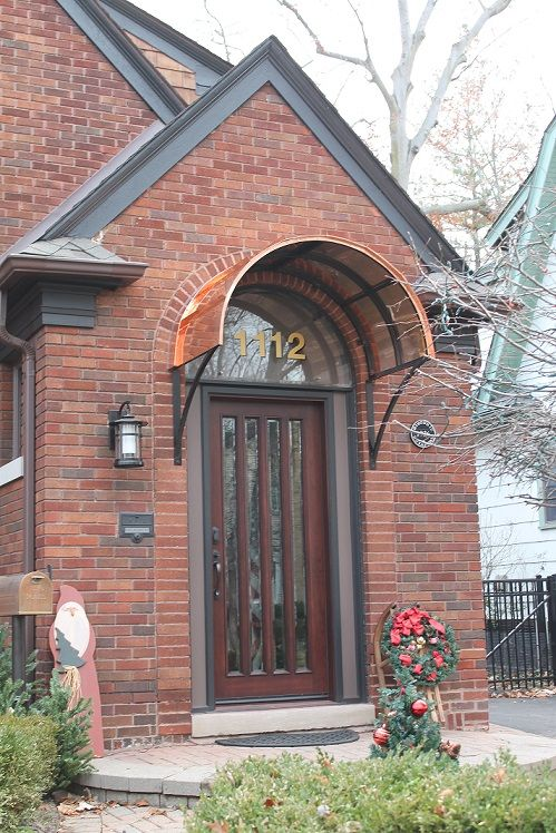 Eyebrow copper door awning in Royal Oaks, MI | Awnings we ...