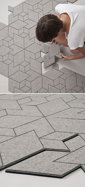Inspired by pavement patterning, Cityscapes is a tiled felt textile that assembles into a geometric floor covering with a city-like grid