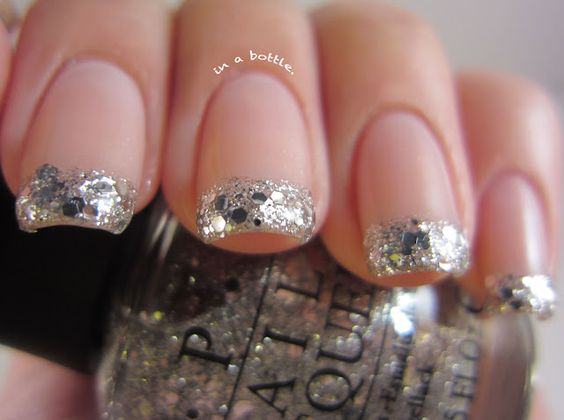 Love this! A glitter french manicure via Gem's in a Bottle blog. Luckily for me, I have the polish to do this. :)
