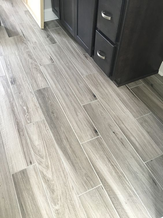 Newly installed gray weathered wood plank tile flooring for Grey bathroom laminate flooring