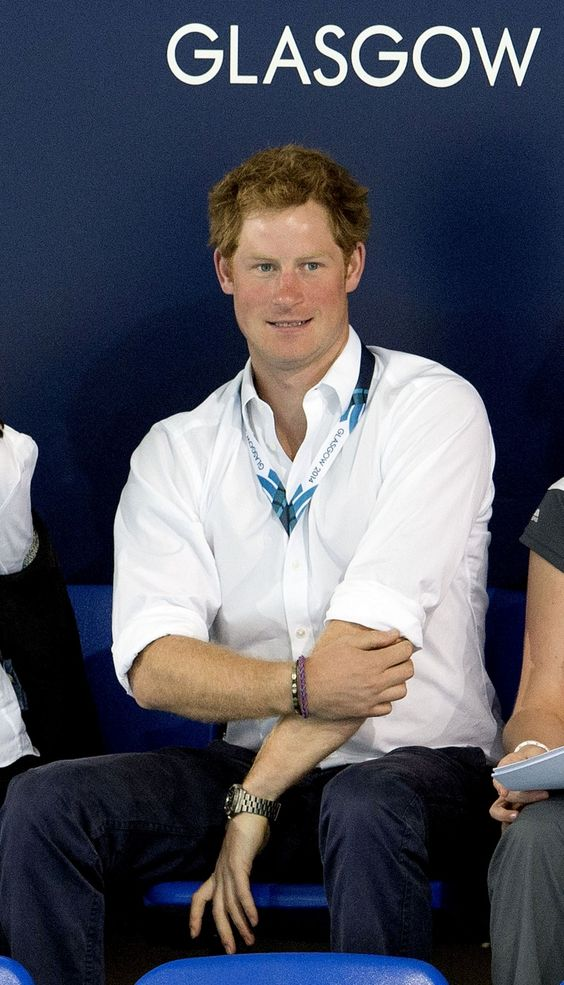 Prince Harry watches the swimming at the 2014 Commonwealth Games in Glasgow.