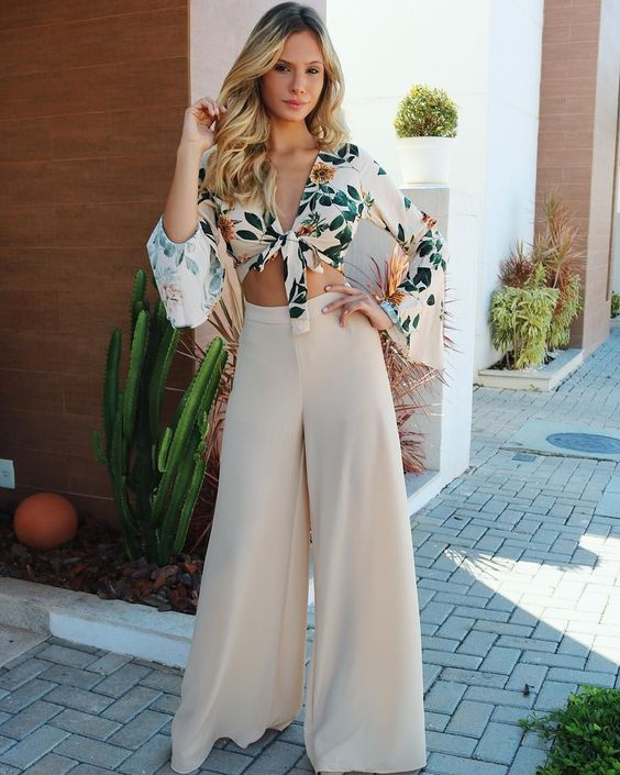 Trendy outfit for summer 2018. Top bikini floral blouse with high waist light texture soft clear wide leg palazzo pants