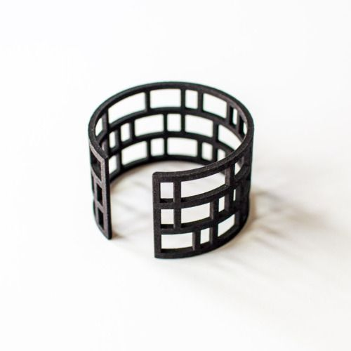 "evrtstudio: "" Spindle Bracelets by EVRT Studio There are now a few of the red and black 3D printed Spindle Bracelets available in my shop! Own a piece of modern architecture for your wrist. Printed 3mm thick in flexible nylon to fit any size wrist. """