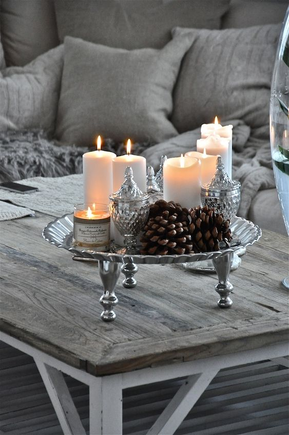 Love the silver, candles and pinecones..can leave it out all winter...also a pretty New Years tablescape.: