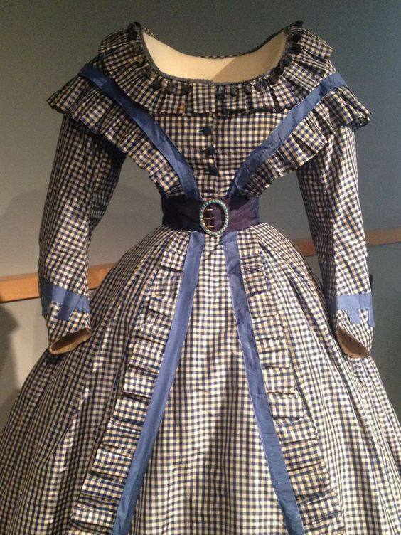 1865 - A gingham silk taffeta gown with an 18-inch waistline