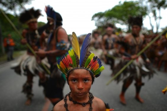 Rio+20 Low on Concrete Outcomes. Photo: Indigenous groups from all over the world participated in the 2012 United Nations Conference on Sustainable Development, Rio+20, in Rio de Janeiro, Brazil. (Christophe Simon/AFP/GettyImages)